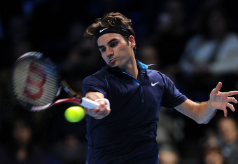 LONDON, ENGLAND - NOVEMBER 26:  Roger Federer of Switzerland returns the ball during the men's semi-final singles match against David Ferrer of Spain  during the Barclays ATP World Tour Finals at the O2 Arena on November 26, 2011 in London, England.  (Pho