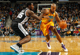 NEW ORLEANS, LA - JANUARY 22:  David West #30 of the New Orleans Hornets drives the ball around DeJuan Blair #45 of the San Antonio Spurs at the New Orleans Arena on January 22, 2011 in New Orleans, Louisiana.  NOTE TO USER: User expressly acknowledges an