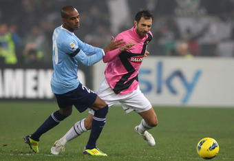 ROME, ITALY - NOVEMBER 26:  Mirko Vucinic (R) of Juventus FC competes for the ball with Abdoulay Konko of SS Lazio during the Serie A match between SS Lazio and Juventus FC at Stadio Olimpico on November 26, 2011 in Rome, Italy.  (Photo by Paolo Bruno/Get