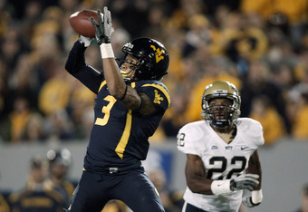 MORGANTOWN, WV - NOVEMBER 25:  Stedman Bailey #3 of the West Virginia Mountaineers catches a pass in front of Antwaun Reed #22 of the University of Pittsburgh Panthers before running in for the touchdown in the first half during the 2011 Backyard Brawl on