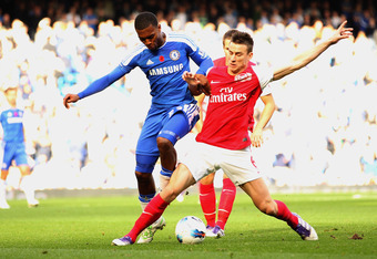 LONDON, ENGLAND - OCTOBER 29:  Laurent Koscielny of Arsenal battles for the ball with Daniel Sturridge of Chelsea during the Barclays Premier League match between Chelsea and Arsenal at Stamford Bridge on October 29, 2011 in London, England.  (Photo by Ia