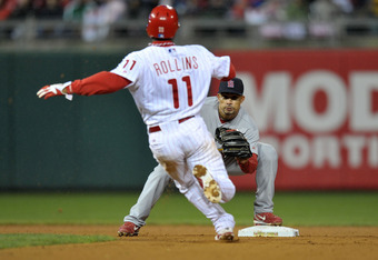 PHILADELPHIA, PA - OCTOBER 02:  Rafael Furcal #15 of the St. Louis Cardinals waits to tag out Jimmy Rollins #11 of the Philadelphia Phillies as he attempts to steal second base in the seventh inning of Game Two of the National League Division Series at Ci