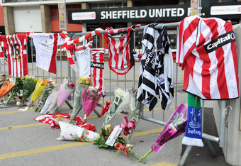 Scarfs and tributes to Gary Speed hang outside Bramall Lane