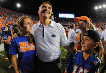 GAINESVILLE, FL - SEPTEMBER 25:  Head coach Urban Meyer of the Florida Gators celebrates with his wife Shelley Meyers and children Gigi Meyers, L, and Nate Meyers, R, after defeating the Kentucky Wildcats at Ben Hill Griffin Stadium on September 25, 2010