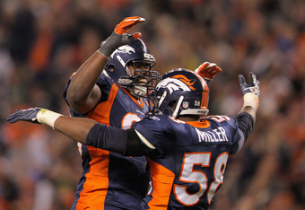 DENVER, CO - NOVEMBER 17:  (L-R) Ryan McBean #98 and Von Miller #58 of the Denver Broncos celebrate a defensive play late in the second quarter against the New York Jets at Invesco Field at Mile High on November 17, 2011 in Denver, Colorado.  (Photo by Do