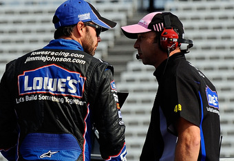 DOVER, DE - SEPTEMBER 30:  (L-R) Jimmie Johnson, driver of the #48 Lowe's/Kobalt Tools Chevrolet, talks with crew chief Chad Knaus during practice for the NASCAR Sprint Cup Series AAA 400 at Dover International Speedway on September 30, 2011 in Dover, Del