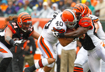 CINCINNATI, OH - NOVEMBER 27:  Peyton Hillis #40 of the Cleveland Browns is tackled by Thomas Howard #53 of the Cincinnati Bengals after running the ball at Paul Brown Stadium on November 27, 2011 in Cincinnati, Ohio.  (Photo by Tyler Barrick/Getty Images