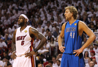MIAMI, FL - JUNE 12: (L-R) LeBron James #6 of the Miami Heat and Dirk Nowitzki #41 of the Dallas Mavericks look on in Game Six of the 2011 NBA Finals at American Airlines Arena on June 12, 2011 in Miami, Florida. The Mavericks won 105-95. NOTE TO USER: Us