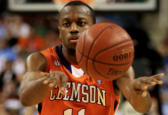 GREENSBORO, NC - MARCH 12:  Andre Young #11 of the Clemson Tigers passes during the first half against the North Carolina Tar Heels in the semifinals of the 2011 ACC men's basketball tournament at the Greensboro Coliseum on March 12, 2011 in Greensboro, N
