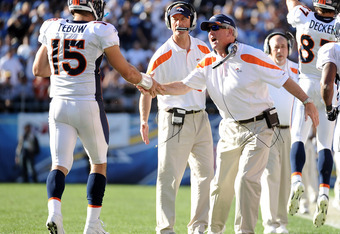 SAN DIEGO, CA - NOVEMBER 27:  Head coach John Fox of the Denver Broncos celebrates a touchdown with Tim Tebow #15 to trail 10-7 to the San Diego Chargers during the second quarter at Qualcomm Stadium on November 27, 2011 in San Diego, California.  (Photo