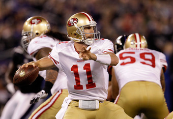 BALTIMORE, MD - NOVEMBER 24:  Alex Smith #11 of the San Francisco 49ers passes against the Baltimore Ravens at M&T Bank Stadium on November 24, 2011 in Baltimore, Maryland.  (Photo by Rob Carr/Getty Images)