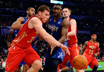 LOS ANGELES, CA - FEBRUARY 20:  Blake Griffin #32 of the Los Angeles Clippers and the Western Conference moves the ball against Amare Stoudemire #1 of the New York Knicks and the Eastern Conference in the 2011 NBA All-Star Game at Staples Center on Februa