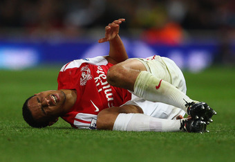 LONDON, ENGLAND - SEPTEMBER 20:  Francis Coquelin of Arsenal is injured during the Carling Cup Third Round match between Arsenal and Shrewsbury Town at Emirates Stadium on September 20, 2011 in London, England.  (Photo by Julian Finney/Getty Images)