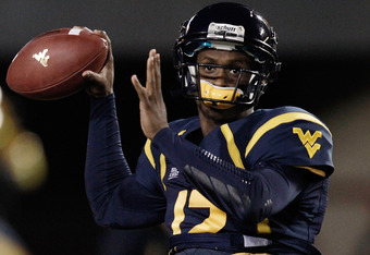 MORGANTOWN, WV - NOVEMBER 25:  Geno Smith #12 of the West Virginia Mountaineers warms up prior to the Backyard Brawl against the University of Pittsburgh Panthers on November 25, 2011 at Mountaineer Field in Morgantown, West Virginia.  (Photo by Jared Wic