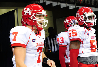 NEW ORLEANS, LA - NOVEMBER 10:  Case Keenum #7, Marcus McGraw #55 and Patrick Edwards #83 of the University of Houston Cougars take the field against the Tulane Green Wave during a game being held at the Mercedes-Benz Superdome on November 10, 2011 in New