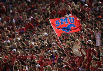DALLAS - SEPTEMBER 24:  Fans of the SMU Mustangs wave a flag during play against the TCU Horned Frogs at Gerald J. Ford Stadium on September 24, 2010 in Dallas, Texas.  (Photo by Ronald Martinez/Getty Images)