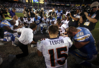 SAN DIEGO, CA - NOVEMBER 27:  Quarterback Tim Tebow #15 of the Denver Broncos prays in the middle of the field with other players during the Broncos 16-13 overtime win over the San Diego Chargers in their NFL Game on November 27, 2011 at Qualcomm Stadium