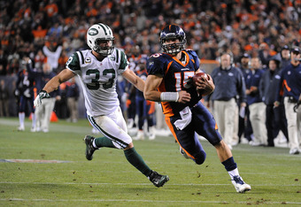 DENVER, CO - NOVEMBER 17: Tim Tebow #15 of the Denver Broncos runs for the game winning touchdown against Eric Smith #33 of the New York Jets at Sports Authority Field at Mile High on November 17, 2011 in Denver, Colorado.  (Photo by Garrett W. Ellwood/Ge