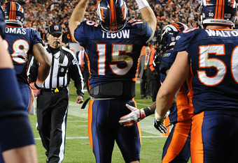 DENVER, CO - NOVEMBER 17: Tim Tebow #15 of the Denver Broncos celebrates after scoring the game winning touchdown against New York Jets at Sports Authority Field at Mile High on November 17, 2011 in Denver, Colorado.  (Photo by Garrett W. Ellwood/Getty Im