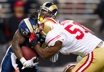 ST. LOUIS, MO - DECEMBER 26: Steven Jackson #39 of the St. Louis Rams is tackled by Takeo Spikes #51 of the San Francisco 49ers at the Edward Jones Dome on December 26, 2010 in St. Louis, Missouri. The Rams beat the 49ers 25-17. (Photo by Dilip Vishwanat/