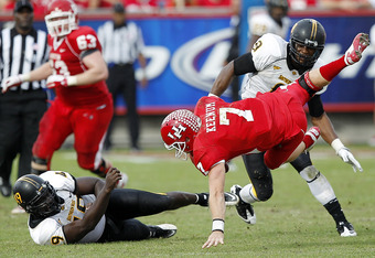 HOUSTON - DECEMBER 03:  Quarterback Case Keenum #7 of the Houston Cougars is sacked by Cordarro Law #49 of the Southern Mississippi Golden Eagles in the fourth quarter at Robertson Stadium on December 3, 2011 in Houston, Texas.  (Photo by Bob Levey/Getty