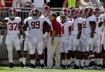 STATE COLLEGE, PA - SEPTEMBER 10:  Head coach Nick Saban of the Alabama Crimson Tide waits to lead his team on the field before the start of their game against the Penn State Nittany Lions at Beaver Stadium on September 10, 2011 in State College, Pennsylv
