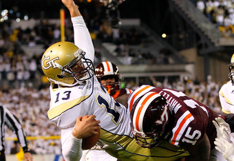 ATLANTA, GA - NOVEMBER 10:  Tevin Washington #13 of the Georgia Tech Yellow Jackets is uplifted and slammed out-of-bounds short of the goal line by Eddie Whitley #15 and Kyle Fuller #17 of the Virginia Tech Hokies at Bobby Dodd Stadium on November 10, 201