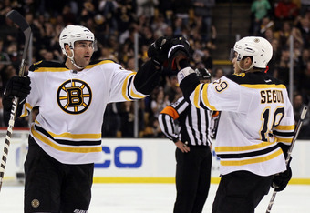 BOSTON, MA - DECEMBER 03:  Johnny Boychuk #55 of the Boston Bruins is congratulated by teammate Tyler Seguin #19 after Boychuk scored a goal in the third period against the Toronto Maple Leafs on December 3, 2011 at TD Garden in Boston, Massachusetts. The