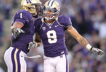 SEATTLE - SEPTEMBER 11:  Wide receiver Devin Aguilar #9 of the Washington Huskies celebrates with Chris Polk #1 after making a 14 yard touchdown catch in the fourth quarter against the Syracuse Orange on September 11, 2010 at Husky Stadium in Seattle, Was