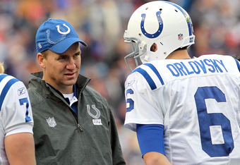FOXBORO, MA - DECEMBER 4:    Peyton Manning #18 of the Indianapolis Colts has words with  Dan Orlovsky #6 of the Indianapolis Colts in the first half at Gillette Stadium on December 4, 2011 in Foxboro, Massachusetts. (Photo by Jim Rogash/Getty Images)
