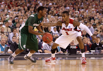 INDIANAPOLIS - MARCH 29:  Kalin Lucas #1 of the Michigan State Spartans drives against Terrence Williams #1 of the Louisville Cardinals  during the fourth round of the NCAA Division I Men's Basketball Tournament at the Lucas Oil Stadium on March 29, 2009