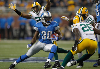 DETROIT, MI - NOVEMBER 24:  Running back Kevin Smith #30 of the Detroit Lions runs the ball in the first quarter against the Green Bay Packers during the Thanksgiving Day game at Ford Field on November 24, 2011 in Detroit, Michigan.  (Photo by Gregory Sha