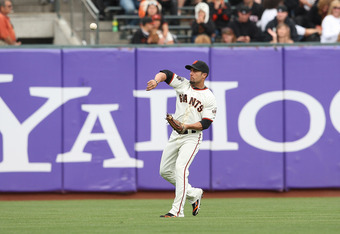 SAN FRANCISCO, CA - SEPTEMBER 14: Andres Torres #56 of the San Francisco Giants throws a ball back into the infield during a game against the San Diego Padres at AT&T Park on September 14, 2011 in San Francisco, California.  (Photo by Tony Medina/Getty Im