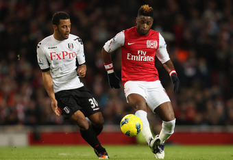 LONDON, ENGLAND - NOVEMBER 26:  Moussa Dembele of Fulham and Alex Song of Arsenal battle for the ball during the Barclays Premier League match between Arsenal and Fulham at Emirates Stadium on November 26, 2011 in London, England.  (Photo by Scott Heavey/