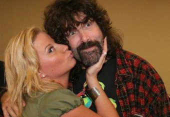 Hall of Famer Sunny gives Mick Foley a memorable day at a 2008 Wrestlers Rescue event. They are two of the stars who can be booked via the foundation's talent agency.