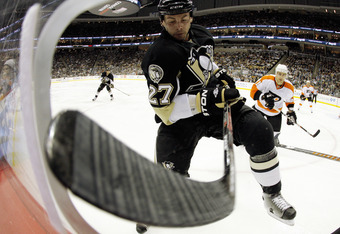 PITTSBURGH, PA - MARCH 29:  Craig Adams #27 of the Pittsburgh Penguins battles in the corner for a puck against the Philadelphia Flyers at Consol Energy Center on March 29, 2011 in Pittsburgh, Pennsylvania.  The Flyers defeated the Penguins 5-2.  (Photo b