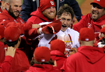 ST LOUIS, MO - OCTOBER 27:  David Freese #23 of the St. Louis Cardinals celebrates at home plate after hitting a walk off solo home run in the 11th inning to win Game Six of the MLB World Series against the Texas Rangers at Busch Stadium on October 27, 20