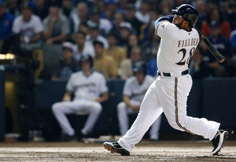 MILWAUKEE, WI - OCTOBER 01:  Prince Fielder #28 of the Milwaukee Brewers hits a two run home run in the 7th inning against the Arizona Diamondbacks during Game One of the National League Division Series at Miller Park on October 1, 2011 in Milwaukee, Wisc