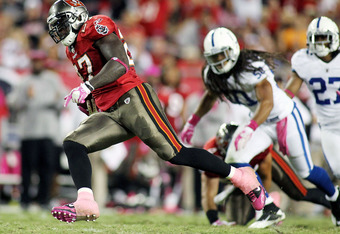 TAMPA, FL - OCTOBER 03: Running back LeGarrette Blount #27 of the Tampa Bay Buccaneers runs for a touchdown against the Indianapolis Colts at Raymond James Stadium on October 3, 2011 in Tampa, Florida.  (Photo by Marc Serota/Getty Images)