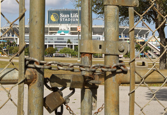 MIAMI GARDENS, FL - MARCH 03:  A view of Sun Life Stadium behind a locked gate as the NFL lockout looms on March 3, 2011 in Miami Gardens, Florida.  (Photo by Mike Ehrmann/Getty Images)