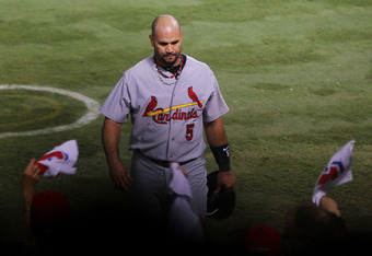 ARLINGTON, TX - OCTOBER 24:  Albert Pujols #5 of the St. Louis Cardinals walks back to the dugout at the end of the seventh inning during Game Five of the MLB World Series against the Texas Rangers at Rangers Ballpark in Arlington on October 24, 2011 in A