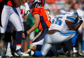 DENVER, CO - OCTOBER 30:  Linebacker Stephen Tulloch #55 of the Detroit Lions reacts by 'Tebowing' after making a sack on quarterback Tim Tebow #15 of the Denver Broncos during the first quarter at Sports Authority Field at Mile High on October 30, 2011 i