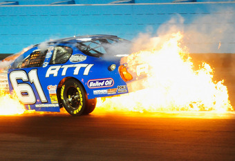 AVONDALE, AZ - NOVEMBER 12:  Brett Thompson, driver of the Rich Thompson Trucking Chevrolet, catches on fire after crashing during the NASCAR K&N Pro Series West Casino Arizona 125 at Phoenix International Raceway on November 12, 2011 in Avondale, Arizona