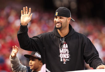 ST. LOUIS, MO - OCTOBER 30: First baseman Albert Pujols of the St. Louis Cardinals waves to the crowd during the World Series victory parade for the franchise's 11th championship on October 30, 2011 in St Louis, Missouri. (Photo by Ed Szczepanski/Getty Im