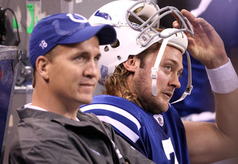 INDIANAPOLIS, IN - NOVEMBER 27:  Peyton Manning and Curtis Painter #7 of the Indianapolis Colts sit on the bench in the final minute of the game against the Carolina Panthers at Lucas Oil Stadium on November 27, 2011 in Indianapolis, Indiana.  The colts l