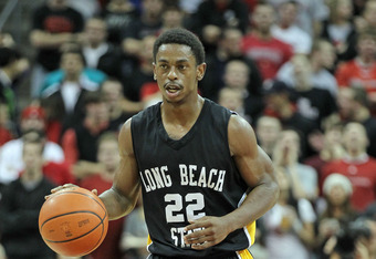 LOUISVILLE, KY - NOVEMBER 28:  Casper Ware #22 of the Long Beach State 49ers dribbles the ball during the game against the Louisville Cardinals at KFC YUM! Center on November 28, 2011 in Louisville, Kentucky.  (Photo by Andy Lyons/Getty Images)