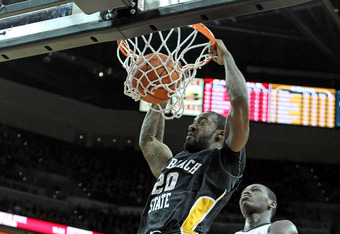 LOUISVILLE, KY - NOVEMBER 28:  T.J. Robinson of the Long Beach State 49ers dunks the ball during the game against the Louisville Cardinals at KFC YUM! Center on November 28, 2011 in Louisville, Kentucky.  (Photo by Andy Lyons/Getty Images)