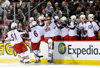 MONTREAL, CANADA - DECEMBER 6: R.J. Umberger #18 of the Columbus Blue Jackets celebrates his second period goal with teammates during the NHL game against the Montreal Canadiens at the Bell Centre on December 6, 2011 in Montreal, Quebec, Canada.  (Photo b