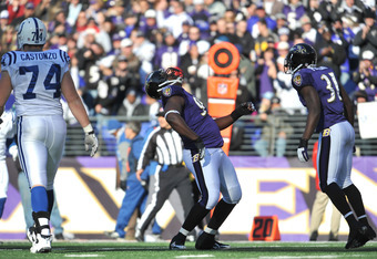 BALTIMORE - DECEMBER 11:  Cory Redding #93 of the Baltimore Ravens celebrates a play against the Indianapolis Colts at M&T Bank Stadium on December 11, 2011 in Baltimore, Maryland. The Ravens lead the Colts 17-3 at the half. (Photo by Larry French/Getty I
