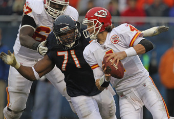 CHICAGO, IL - DECEMBER 04:  Tyler Palko #4 of the Kansas City Chiefs is pursued by Israel Idonije #71 of the Chicago Bears at Soldier Field on December 4, 2011 in Chicago, Illinois. The Chiefs defeated the Bears 10-3.  (Photo by Jonathan Daniel/Getty Imag